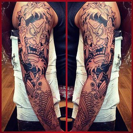 Hình xăm cá chép mặt quỷ trên cánh tay